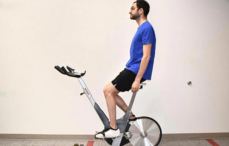 man on exercise bike demonstrating seat distance