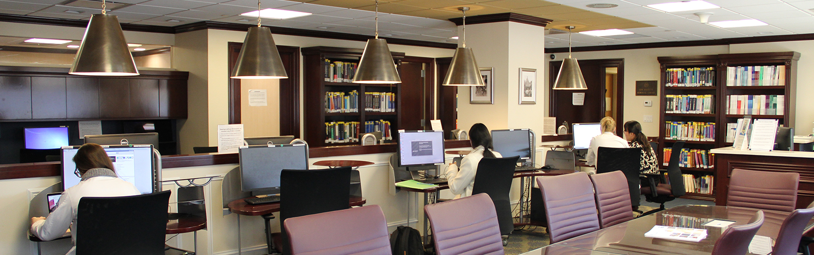 Banner image of the inside of the Kim Barrett Memorial Library
