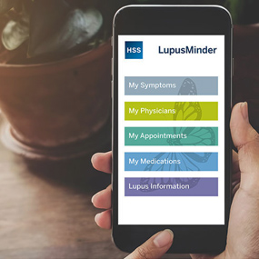 Photo of mobile phone with Lupus Minder app.