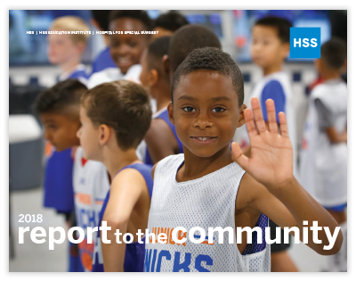 2018 report to the community cover, Junior Knicks player at a Sports Safety event