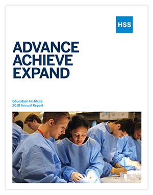 HSS Education Institute 2018 Annual Report Publication Cover, resident and Dr. Fufa in the bioskills lab