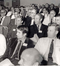 Historical photo of an alumni meeting audience