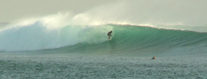 Photo of John surfing