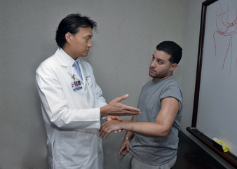 Photo of Dr. Steven K. Lee examining a patient