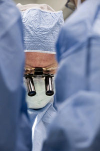 Photo of a surgeon performing microsurgery