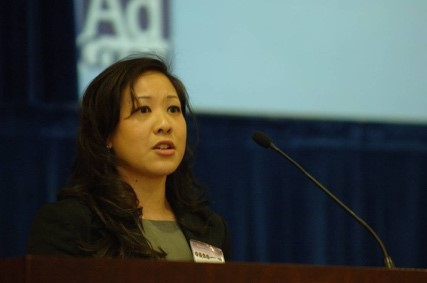 Photo of LANtern founder Karen Ng speaking at a luncheon.