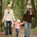A family walking in the woods