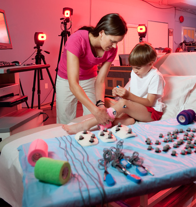 Lisa Cannegieter, PT, DPT, with child in Motion Analysis Lab