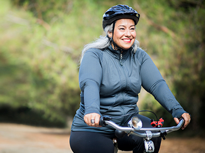 smiling woman on bicycle