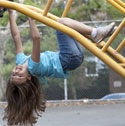 Photo of a child playing on a jungle gym