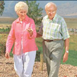 Photo of a senior couple walking in a field