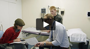 Video thumbnail image of Dr. Peter Fabricant speaking with a pediatric patient and his family.