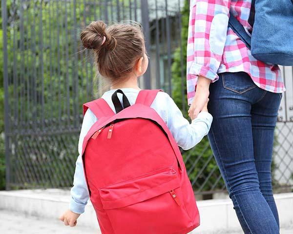 photo of parent walking daughter to school