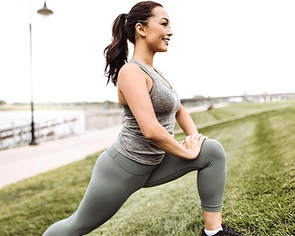 photo of woman stretching outside