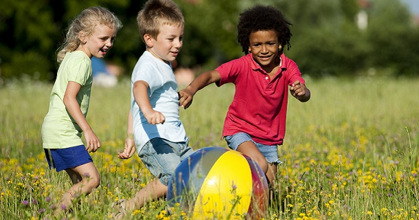 Multi-ethnic children playing ball