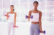 Two women working out with dumbell weights
