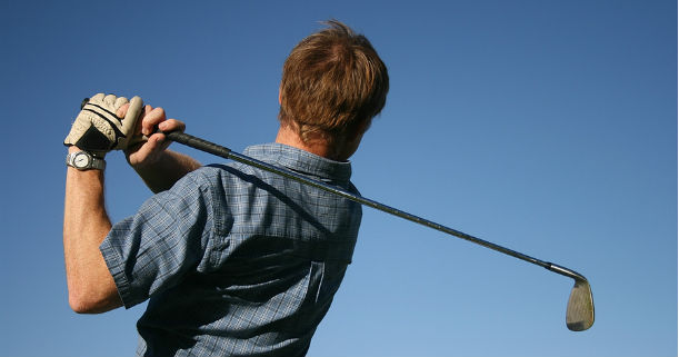 Golfer at end of swing
