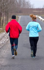 Couple jogging in cold weather