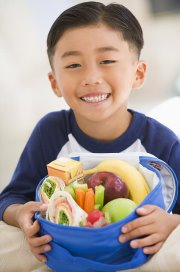 Child with a healthy lunch