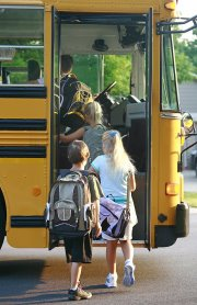 Students boarding a school bus
