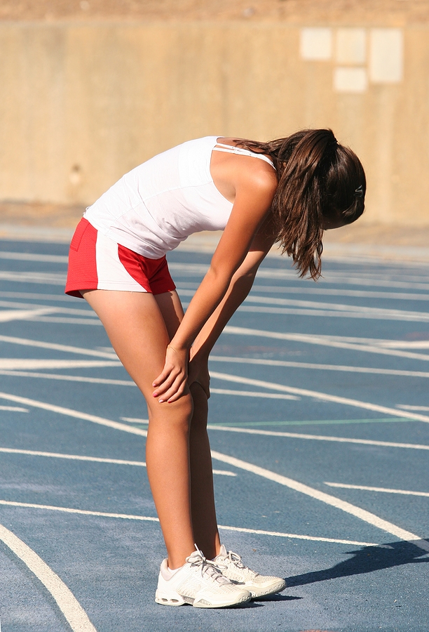 Tired female athlete on running track