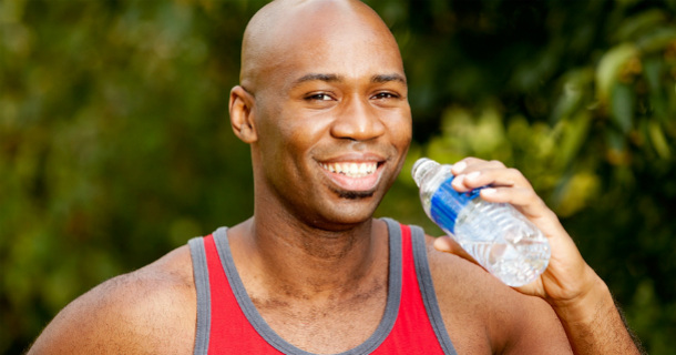 Male athlete with bottled water