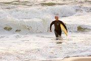Surfer wading ashore