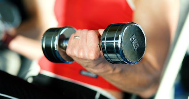 Person lifting dumbell