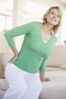 Woman with sciatic pain clutching lower back