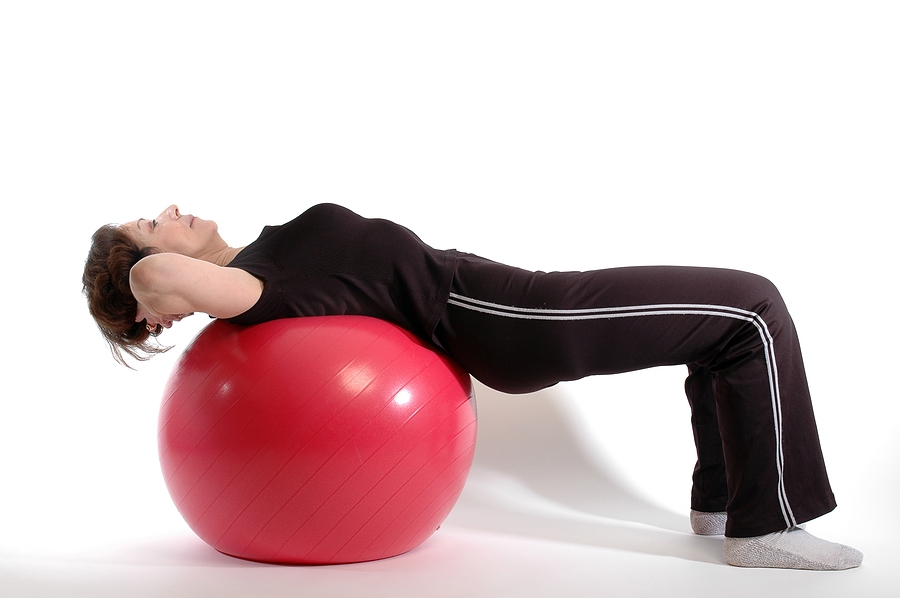 Woman doing sit-ups on fitness ball