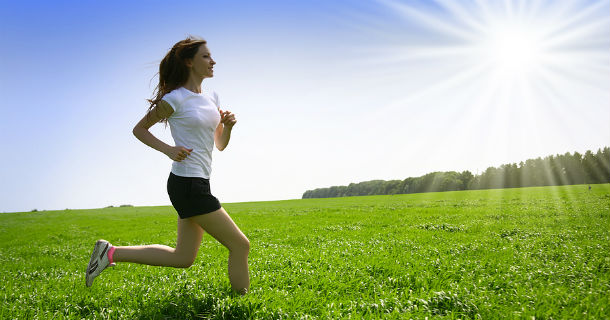 Girl running through a field