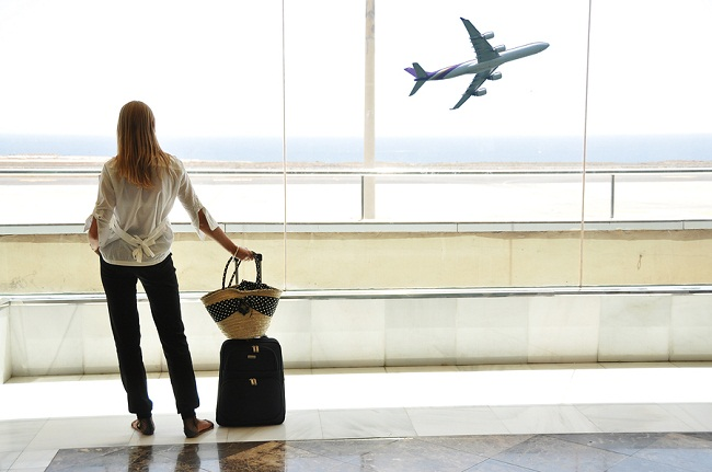 bigstock-Girl-at-the-airport-window