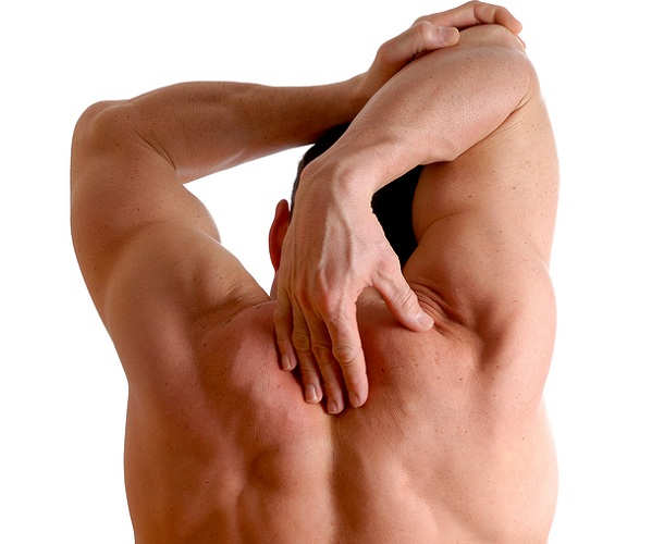 Man performing stretches to help back and neck