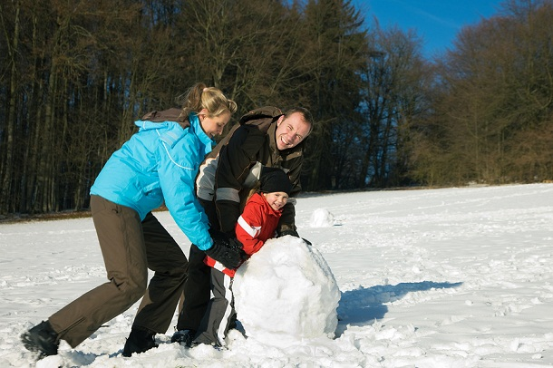bigstock-Family-with-kids-snowman