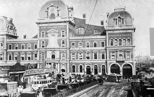The southern fa?ade of Grand Central Depot, circa 1880, with a collection of hansoms and horse-drawn jitneys lined up. 