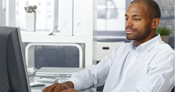 Man at Computer 610x320
