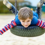 Image - Child on Tire Swing