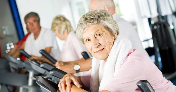 older people being active in gym