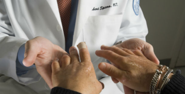 Doctor analyzing patient's hands