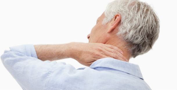 man holding neck in pain