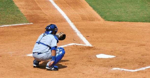 baseball catcher crouching at plate