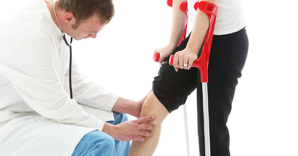 physician examining knee