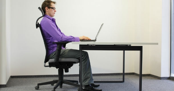 sitting at desk with perfect posture