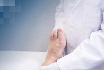 Doctor analyzing patient's foot