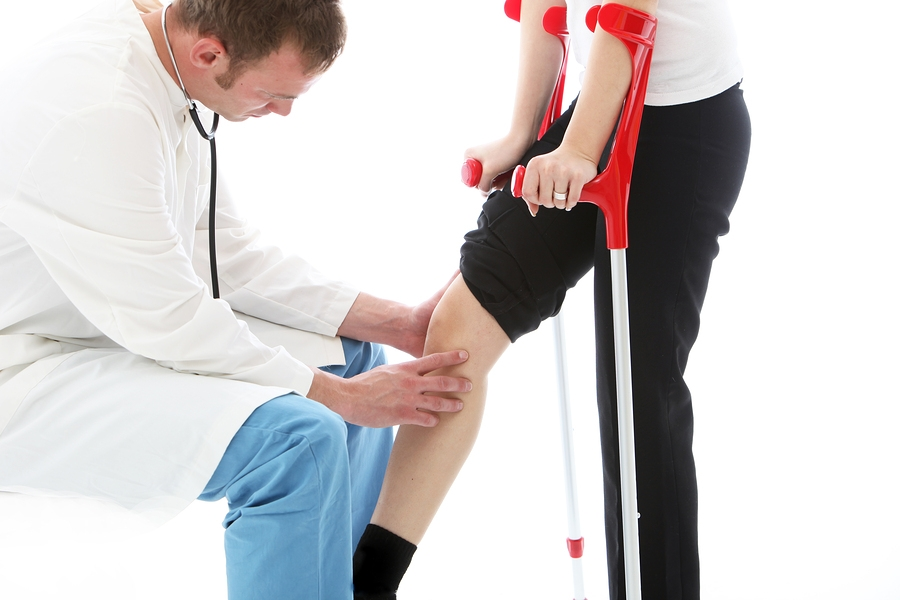 physician examining patient's knee