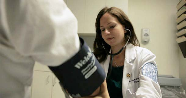 Dr. Jessica Gordon checking patient's blood pressure