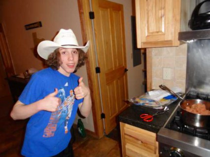 Isaiah cooking wearing cowboy hat__1424299241_74.117.136.120