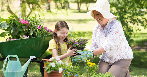 grandmother gardening with grandchild