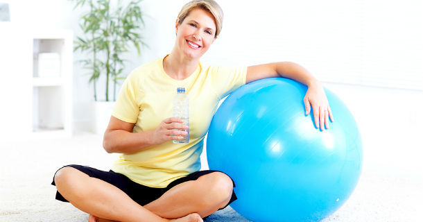 woman with water and exercise ball