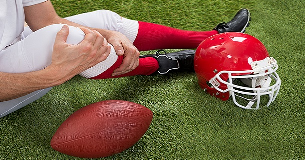 Close-up Of Injured American Football Player On Field